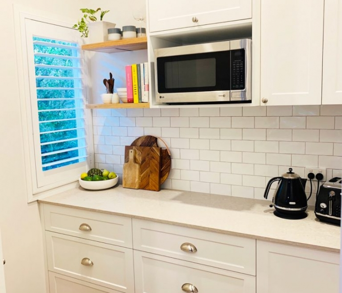 Beautiful white kitchen with Ceaserstone Clambshell Benchtop designed and built by Gecko Kitchens Brisbane