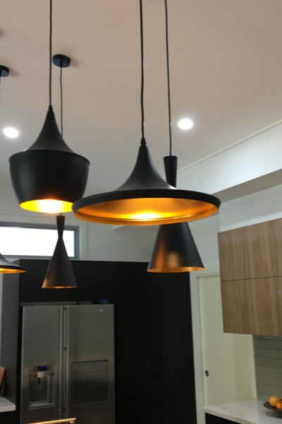 Dress up your kitchen with some stylish pendant lighting. Kitchen built and designed by Gecko Kitchens, licenced builder for kitchens, bathrooms and laundries.