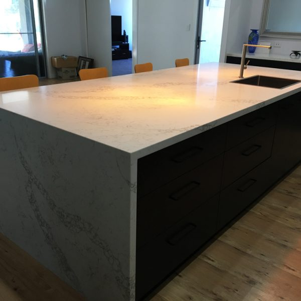 Kitchen bench with stone benchtop built by Gecko Kitchens a licenced builder of kitchens, bathrooms and laundries.